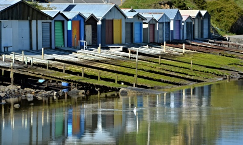 The colourful boatsheds at Duvachelle