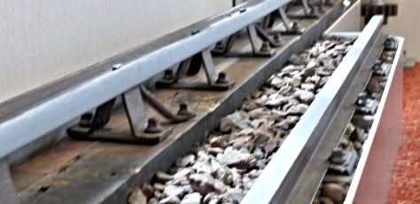A display showing how the centre rail, the one on the left was for the loco to grip onto for traction and braking. The normal rail on the right.