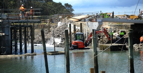 A digger in the water preparing the bridge