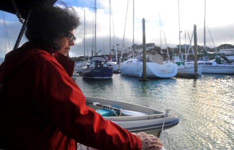 Fiona keeping the dinghy away from the prop in the marina
