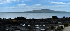 Fishing off the rocks half way around. Rangitoto behind