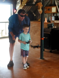 Rob showing Ayden how to pilot a drone