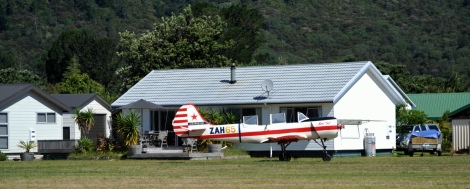 A house with a plane outside