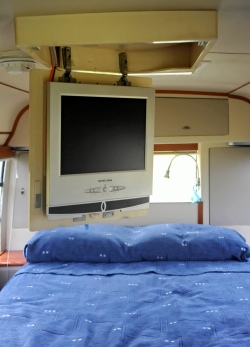 The swivel tv above the bed