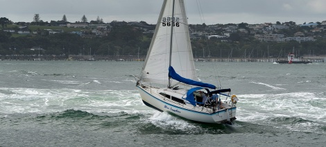 A Yacht struggles in the wash