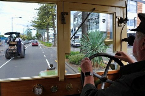 The view out of the windscreen of the 1918 bus. Steam roller in front