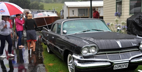 Shawn and Kathys Dodge with onlookers in the rain