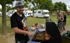 An NZMCA volunteers doing the sausage sizzle at the school