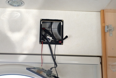 The Truma panel with the TV wiring behind