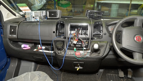 The stereo on the dash with the blue sub wires plugged in