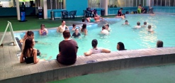 People enjoying the indoor pool