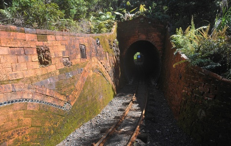 A train coming through the tunnel with Barry's tiles