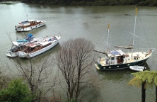 Boats moored below the pub