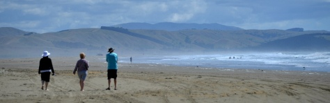 Fiona, Helen and Rob walking along Porangahau Beach