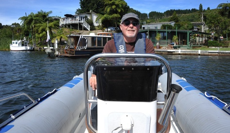 Alan on the helm with Frasers house behind