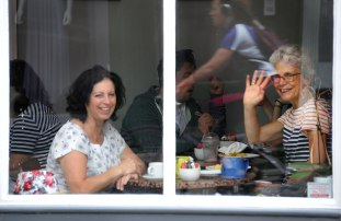Fiona and Hilary enjoying lunch on the bridge. A refection of a cyclist riding by in the window.