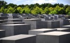 You can see a persons head popping up through the concrete blocks at the Jewish Memorial