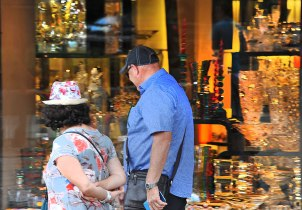Fiona and Gary looking at all the glitzy stuff in a shop window.