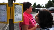 Dianne and Fiona checking out the bus timetable.