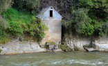 The old Pumphouse on the side of the river