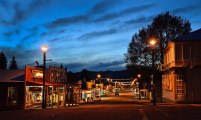 Dusk looking down Reeftons main street with the old lights lighting the street.
