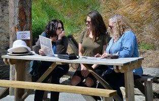 Fiona Jessa and Sara discussing the menu.