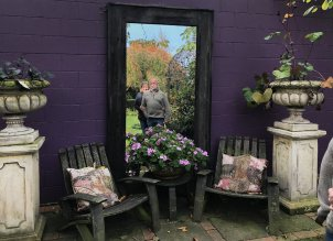 Ollie and Pam reflected in a Garden display