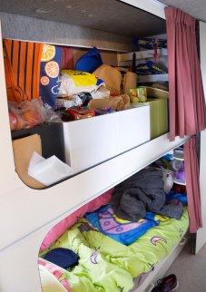 Bunks for the grandkids.. one used as storage.