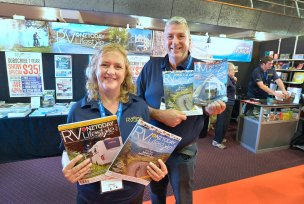 Owners of the RV Travel and Lifestyle Magazine, Robyn and Bruce on their stand.