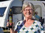 Karen with a bottle of her Olive oil